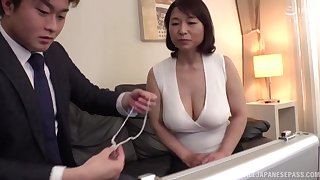 Horny Japanese mature Tokita Kozue enjoys riding a younger neighbor