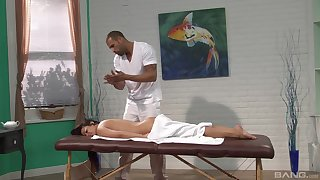 Mia Lelani pleasured by the massage expert with a strapping Hawkshaw